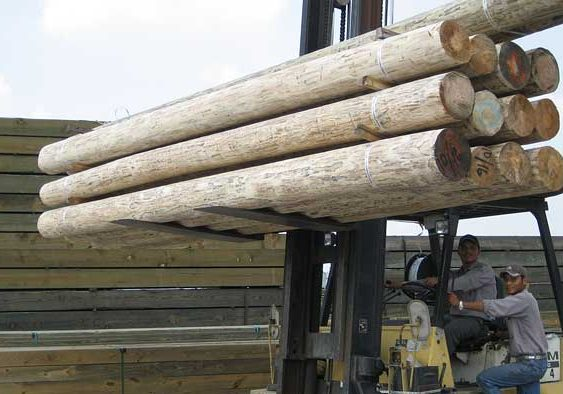 wood poles on fork lift